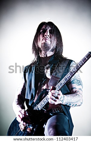 SEATTLE - SEPTEMBER 1, 2012:  Rock guitarist Dave Navarro of Jane's Addiction performs on stage during Bumbershoot in Seattle on September 1, 2012. - stock photo
