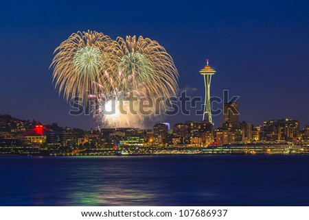 Seattle skyline and Space Needle with fireworks - stock photo