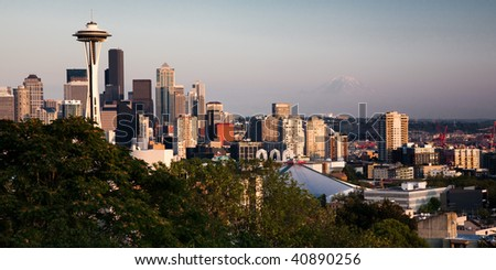 Seattle skyline at sunset with the snow cap of Mt. Rainier in the background - stock photo