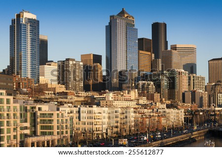 Seattle Skyline. The Seattle skyline along the waterfront with apartments and condos and the Alaskan Way viaduct. Modern skyscrapers provide a lovely backdrop. - stock photo