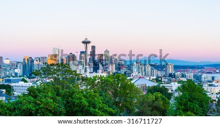 Seattle skyline with Mount Rainier in the background during sunset. - stock photo