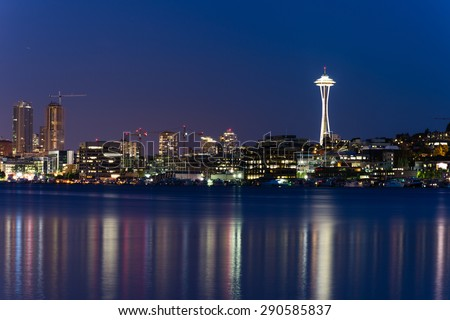 Seattle Skylines with light reflection on Lake Union in blue hour. The view from Gas Works Park a tourists attraction and popular local place. - stock photo