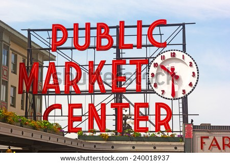 SEATTLE, USA - JUNE 16, 2013: Public Market Center sign in Seattle downtown on June 16, 2013. Pike street market is famous for fresh produce, delicious food and unique arts and crafts. - stock photo