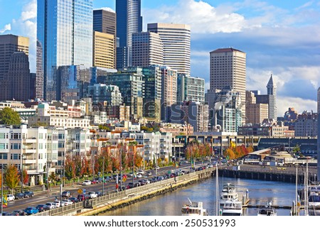 SEATTLE, USA - OCTOBER 26, 2014: City downtown near the piers along Indian freeway in Seattle on October 26, 2014. Breathtaking views attract locals and tourists to the waterfront in all seasons. - stock photo
