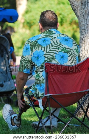 SEATTLE, WA__CIRCA JULY 9, 2012__Disabled man wearing a prosthetic leg following a limb amputation fighting in the war.  circa July 9, 2012. - stock photo