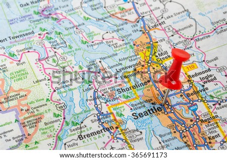 Seattle, WA, Highlighted with a Red Pushpin on an Atlas. Shallow Deep of Field - stock photo