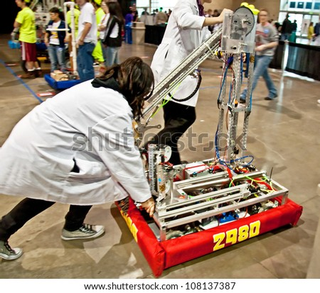 SEATTLE, WA - MARCH 17:  Teens competed at a state  level competition for science and technology robotics competition.  Held on March 17, 2011 in Seattle, WA. - stock photo