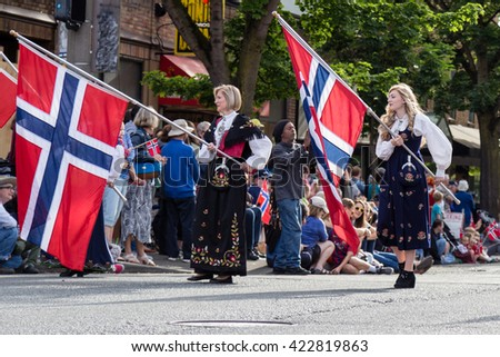 SEATTLE, WA MAY 17 2016: A scene from the annual Norwegian Constitution Day parade in the Seattle neighborhood of Ballard, which is known for having a large Norwegian population. - stock photo