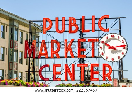 Seattle, WA, USA - July 8, 2014: Pike Place Market Neon Sign. Pike Place Market is a farmers market that was founded in 1907 to provide a place for customers to meet directly the producers.  - stock photo