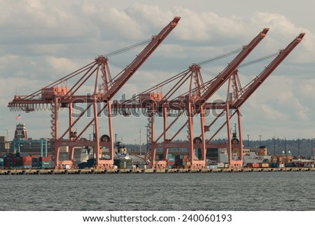 SEATTLE, WA/USA - March 23, 2014: Inactive container cranes at the Port of Seattle waiting for ships to dock to off-load containers. - stock photo