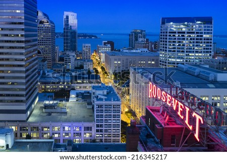 SEATTLE, WASHINGTON AUGUST 8. Faint, predawn light illuminates this aerial view of downtown Seattle with the historic Roosevelt Hotel sign, Pine street to Pike Place Market and Elliott Bay.  - stock photo