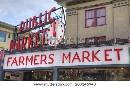Seattle, Washington - August 30, 2013: Famous Seattle Landmark Pike Place Farmer''s Market, drawing 10 million tourists and residents yearly  to buy from local fishermen, farmers and craftspeople. - stock photo
