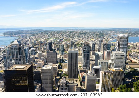 SEATTLE, WASHINGTON - AUGUST 7, 2013: View of the city looking north from the 76th floor of the Columbia Center. The Space Needle is dwarfed by the high-rise office towers in the downtown area. - stock photo