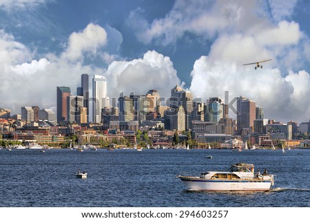 Seattle Washington City Skyline from Lake Union with White Clouds and Blue Sky - stock photo