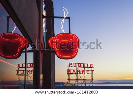SEATTLE, WASHINGTON/UNITED STATES -Â?Â? SEPTEMBER 2: Neon Public Market sign and steaming cup of coffee in Pike Place Market in Seattle, Washington on September 2, 2012. - stock photo