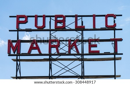 SEATTLE, WASHINGTON, USA - JULY 12, 2015: Large neon Public Market sign at the Pike Place Market in Seattle - stock photo
