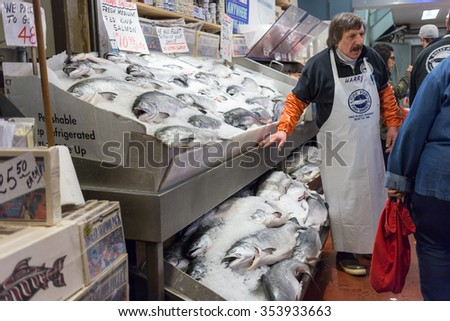Seattle, Washington, USA - March 1, 2015_Fresh seafoof display at Pike Place Public Market in Seattle. - stock photo
