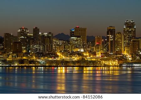 Seattle Washington Waterfront Skyline and Mountain Range at Dawn - stock photo