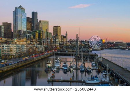 Seattle Waterfront at dusk. Seattle, WA USA - February, 17 2015. Waterfront is the most popular tourism attraction in Seattle. - stock photo