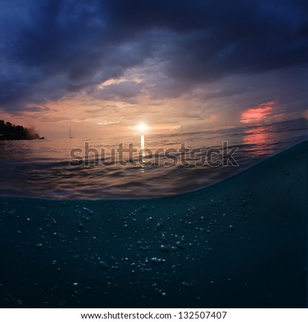 Seaview design template.  Green blue colored ocean surface at sunset time - stock photo