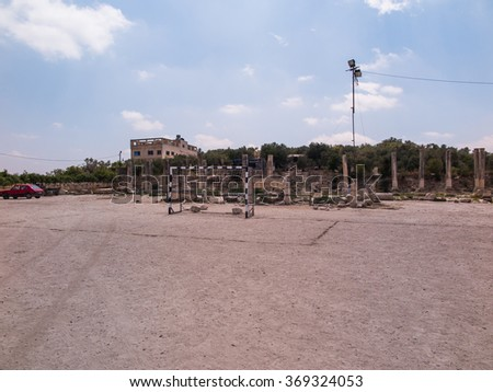 Sebastia Samaria, ancient Israel, ruins and excavations in the Palestinian territories. Football field and parking in close proximity to the ruins of ancient columns - stock photo