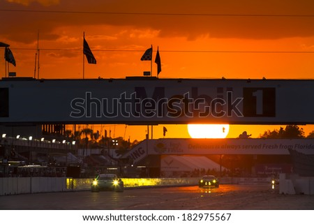 Sebring, FL - Mar 15, 2014:  The Tudor United SportsCar Championship teams take to the track at sunset for the 12 Hours of Sebring at Sebring International Raceway in Sebring, FL. - stock photo