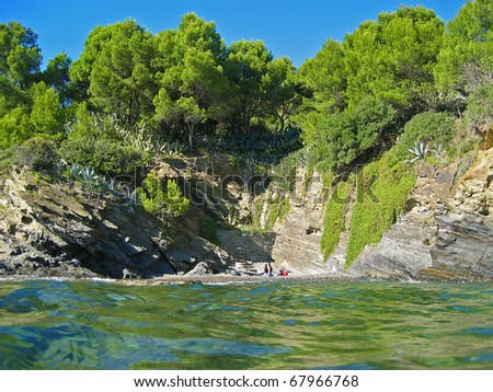 Secluded Mediterranean cove from sea surface with beautiful vegetation,Rosas , Catalonia, Costa Brava, Spain - stock photo