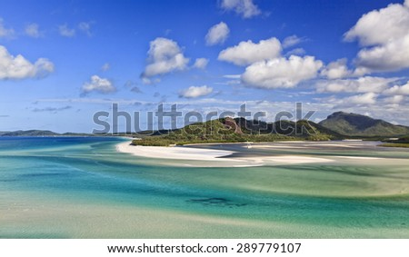 Secluded pristine shallow lagoon of white silica sand and transparent water form part of coral sea around WHitsunday group of islands in Great Barrier reef - stock photo