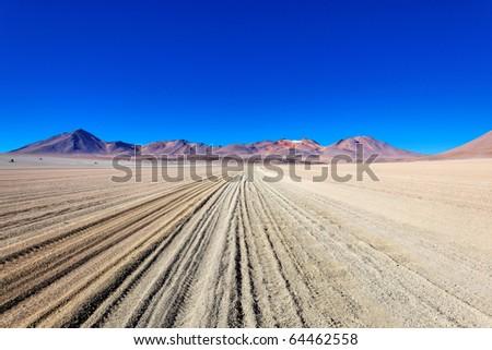 Secluded road in Atacama desert, Bolivia - stock photo