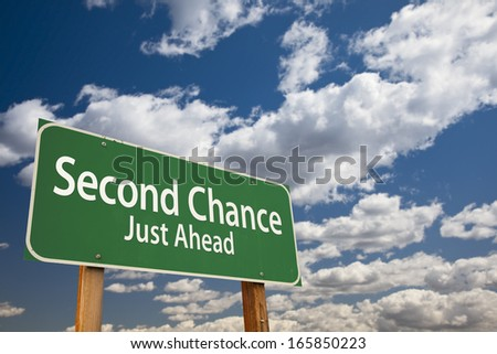 Second Chance Just Ahead Green Road Sign Over Dramatic Clouds and Sky. - stock photo