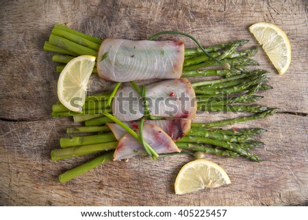 Second course of swordfish and asparagus side dish - stock photo