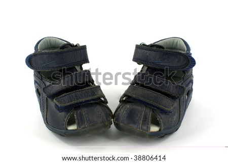 second-hand blue child's sandals on white background - stock photo