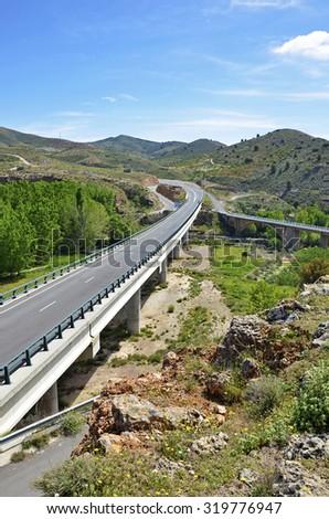 secondary road and bridge - stock photo
