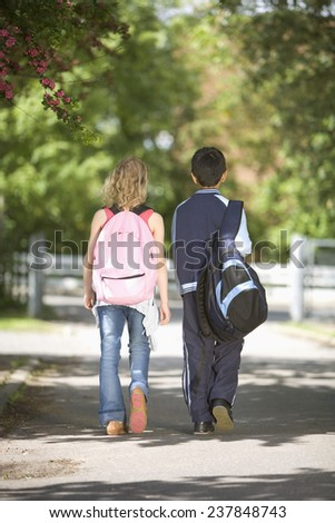 Secondary School Students Walking in Park - stock photo