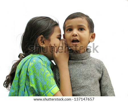 Secret talking in pakistani Sibling - stock photo