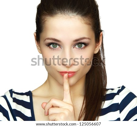 Secret woman. Female showing hand silence sign isolated on white background - stock photo
