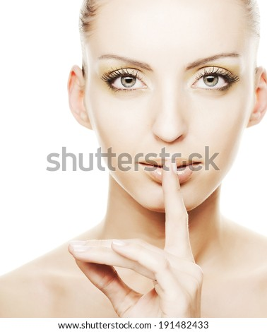 secret - Young girl with her finger over her mouth - stock photo