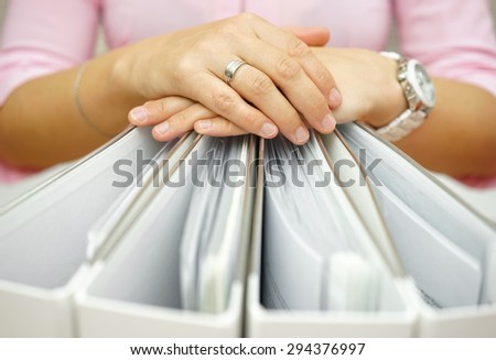 Secretary holding binders, concept of accounting,business,documentation,paperwork - stock photo