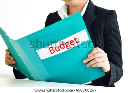 Secretary holding budget document file  - stock photo