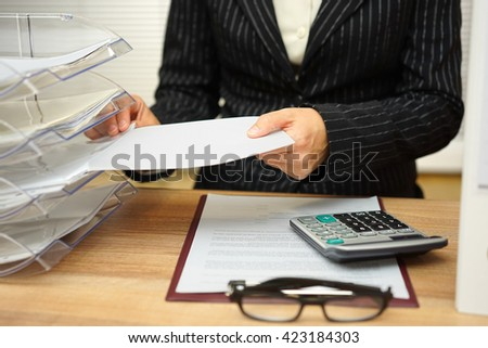 secretary is organizing files and documents - stock photo