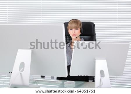 Secretary portrait in a clean high tech office - stock photo