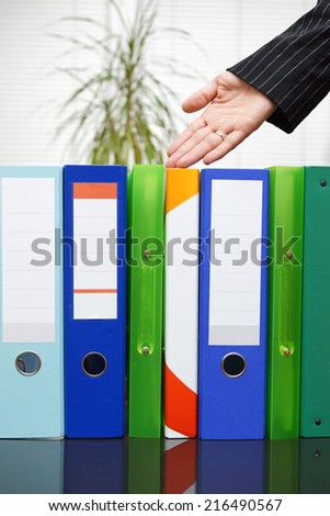 secretary shows well organized documentation - stock photo