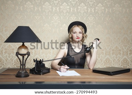 secretary takes notes during a call - stock photo