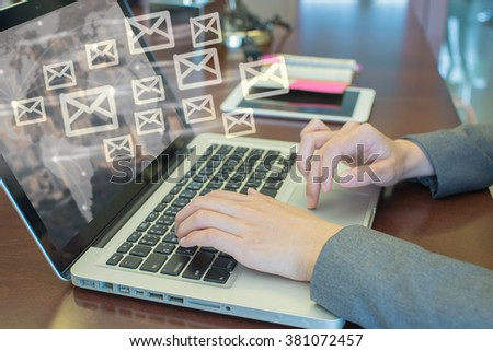 secretary use computer sending e-mails from your computer,email concept - stock photo