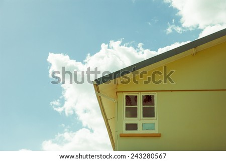 section of a house against the sky in the caribbean - stock photo
