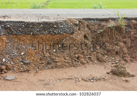 Section of asphalt road in a rural area with Paddy. - stock photo