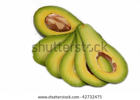 Section of avocado with stone isolated on white background - stock photo