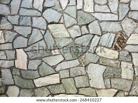 section of flagstone wall with varying shapes and lines - stock photo