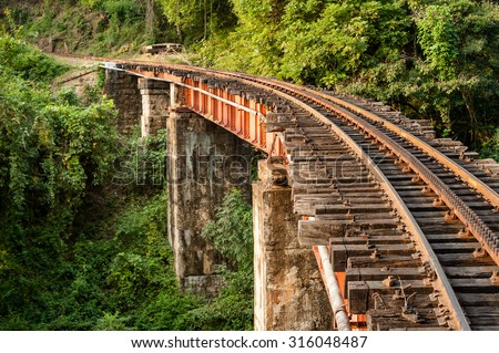 Section of the track and a bridge on the Nilgiri mountain railway at Mettupalayam.  The rack and pinion railway runs between Mettupalayam and Udagamandalam also known at Ooty, in South India. - stock photo