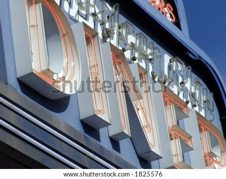 Sectional shot of neon diner sign detail. - stock photo